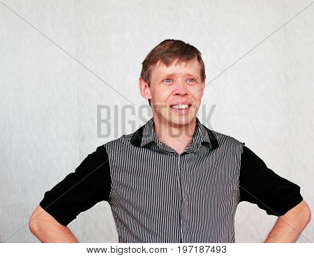 Portrait of smiling middle aged man isolated on neutral background.