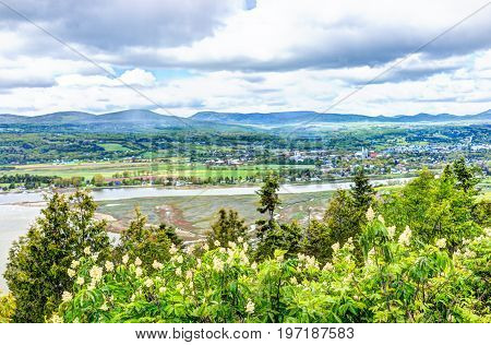 Baie-saint-paul In Quebec, Canada Cityscape Or Skyline With Buildings, Mountains On Coast And Saint