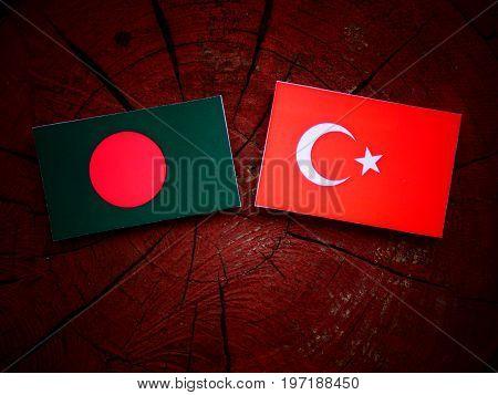 Bangladesh Flag With Turkish Flag On A Tree Stump Isolated