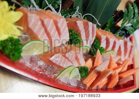 Crab stick and salmon sushi japanese raw fish sashimi set served with crab stick (Kanikama) on ice dish