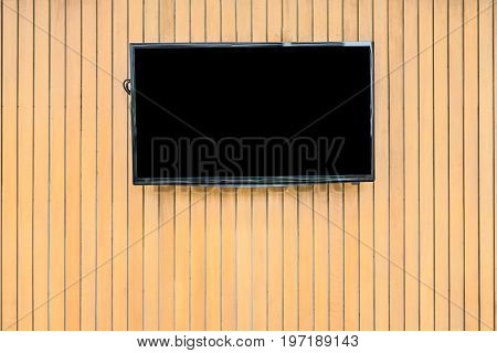Blank lcd Flat screen television hanging at the planks wooden wall