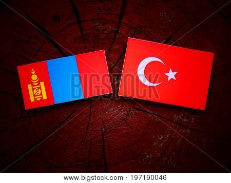 Mongolian Flag With Turkish Flag On A Tree Stump Isolated