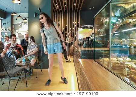 Istanbul, Turkey - June 02, 2017: Young Woman At Starbucks Coffee Shop In Istanbul.