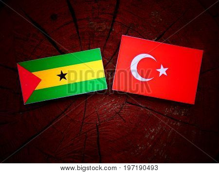 Sao Tome And Principe Flag With Turkish Flag On A Tree Stump Isolated
