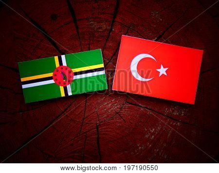 Dominica Flag With Turkish Flag On A Tree Stump Isolated