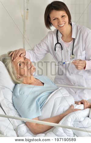 female doctor taking care of senior patient