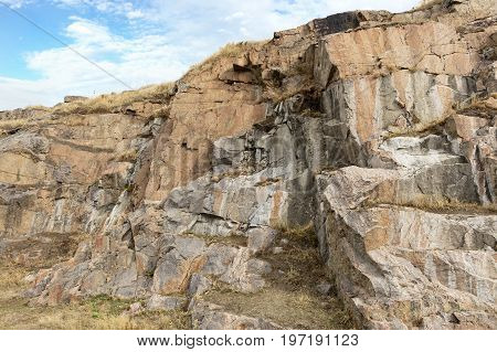 Granite and basalt rock formations against the background of a deep blue sky