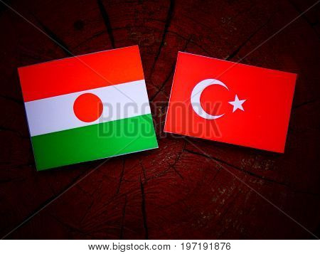 Niger Flag With Turkish Flag On A Tree Stump Isolated