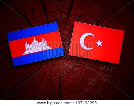 Cambodian Flag With Turkish Flag On A Tree Stump Isolated