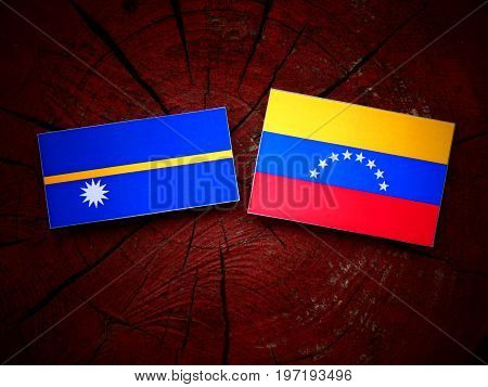 Nauru Flag With Venezuelan Flag On A Tree Stump Isolated