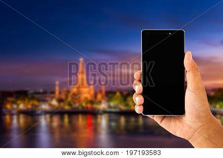 Hand Using Smartphone With View Of Watarun Thailand For Travel