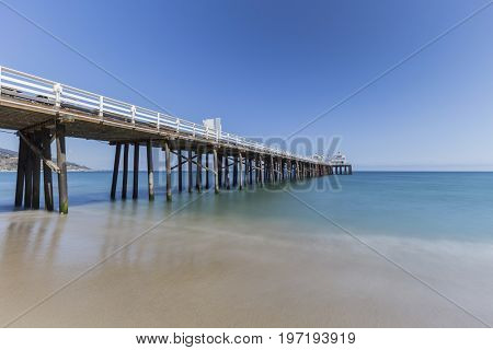 Malibu Pier beach with motion blur water near Los Angeles in California.