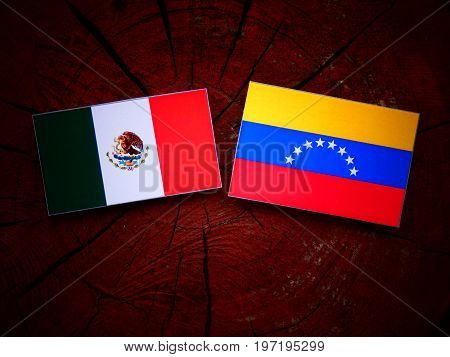 Mexican Flag With Venezuelan Flag On A Tree Stump Isolated