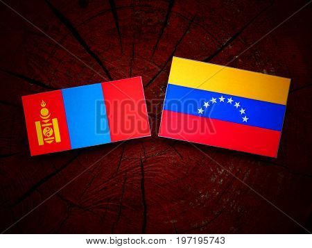 Mongolian Flag With Venezuelan Flag On A Tree Stump Isolated