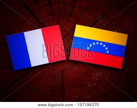 French Flag With Venezuelan Flag On A Tree Stump Isolated