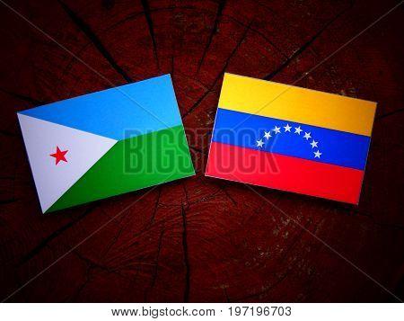 Djibouti Flag With Venezuelan Flag On A Tree Stump Isolated
