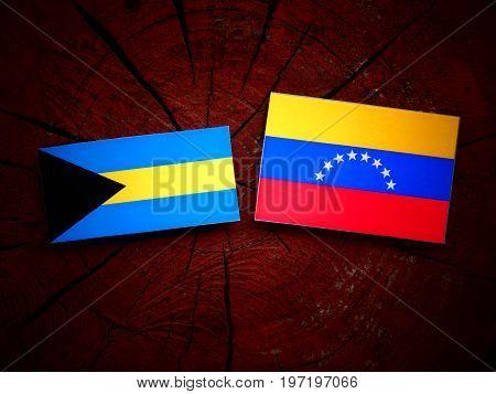 Bahamas Flag With Venezuelan Flag On A Tree Stump Isolated