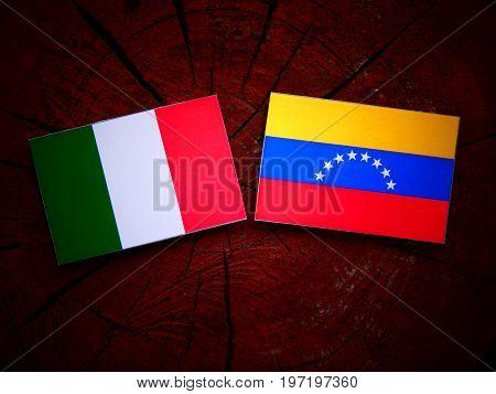 Italian Flag With Venezuelan Flag On A Tree Stump Isolated