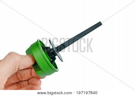 Spare parts Engine Oil Dipstick with drop oil. The gauge of level of oil in the car. Isolated white background