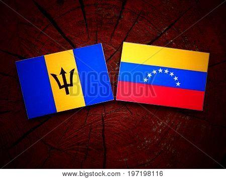 Barbados Flag With Venezuelan Flag On A Tree Stump Isolated