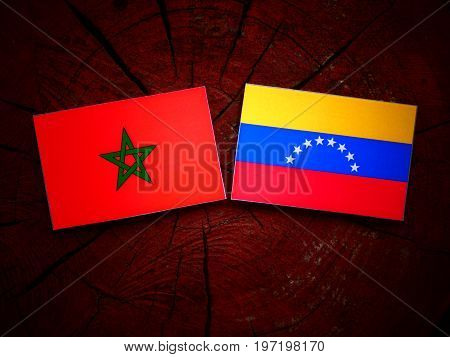 Moroccan Flag With Venezuelan Flag On A Tree Stump Isolated