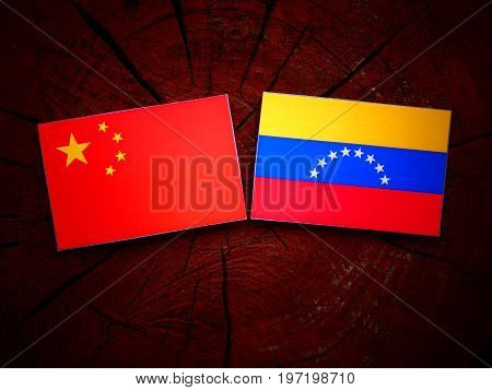 Chinese Flag With Venezuelan Flag On A Tree Stump Isolated