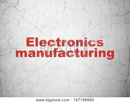 Industry concept: Red Electronics Manufacturing on textured concrete wall background