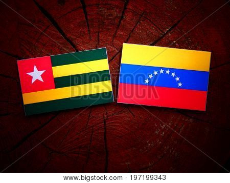 Togolese Flag With Venezuelan Flag On A Tree Stump Isolated