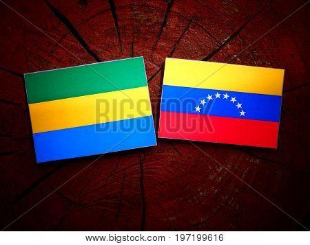 Gabon Flag With Venezuelan Flag On A Tree Stump Isolated