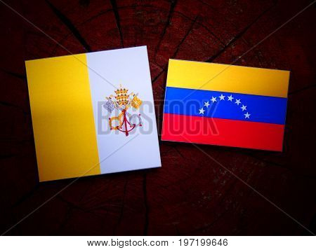 Vatican Flag With Venezuelan Flag On A Tree Stump Isolated