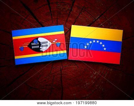 Swaziland Flag With Venezuelan Flag On A Tree Stump Isolated