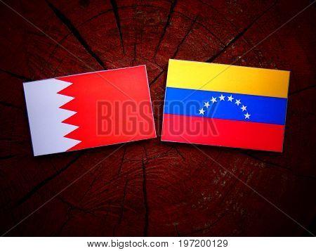 Bahrain Flag With Venezuelan Flag On A Tree Stump Isolated