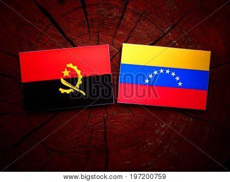 Angolan Flag With Venezuelan Flag On A Tree Stump Isolated