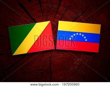 Republic Of The Congo Flag With Venezuelan Flag On A Tree Stump Isolated