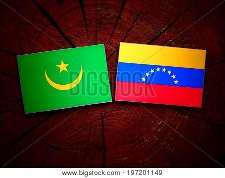 Mauritania Flag With Venezuelan Flag On A Tree Stump Isolated