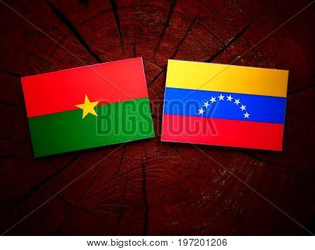 Burkina Faso Flag With Venezuelan Flag On A Tree Stump Isolated
