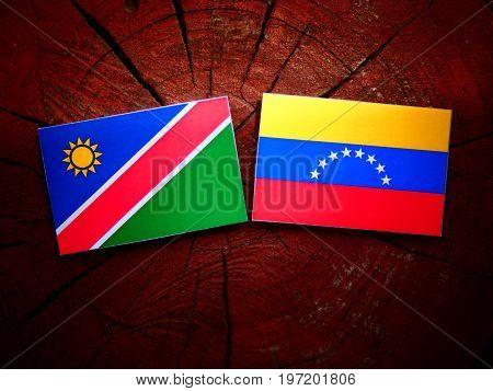 Namibian Flag With Venezuelan Flag On A Tree Stump Isolated