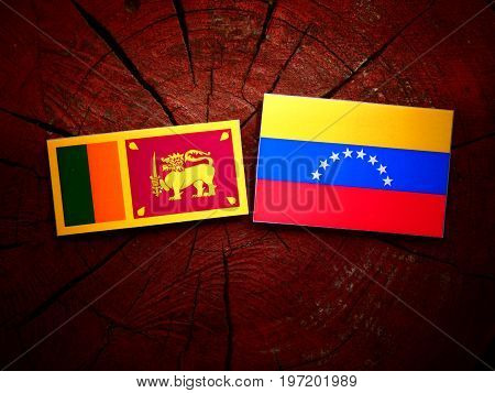 Sri Lankan Flag With Venezuelan Flag On A Tree Stump Isolated