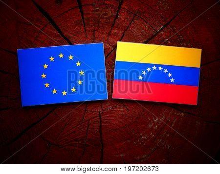 Eu Flag With Venezuelan Flag On A Tree Stump Isolated