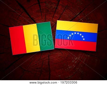 Guinean Flag With Venezuelan Flag On A Tree Stump Isolated
