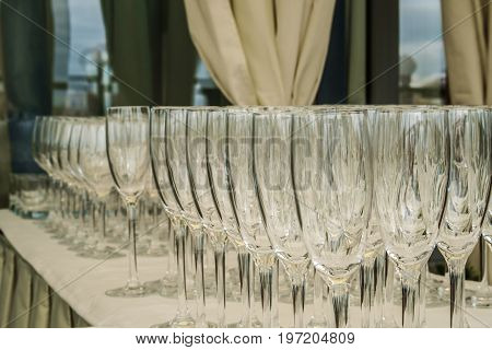 Empty glasses rows on the table in the restaurant
