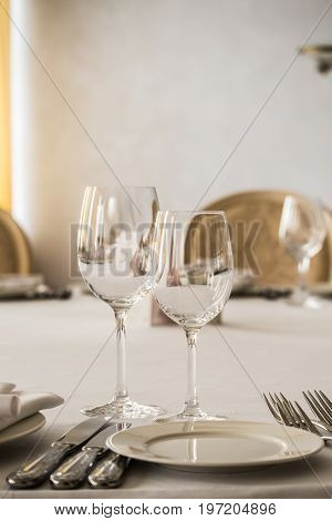 Empty glasses and plates set on the table in the restaurant