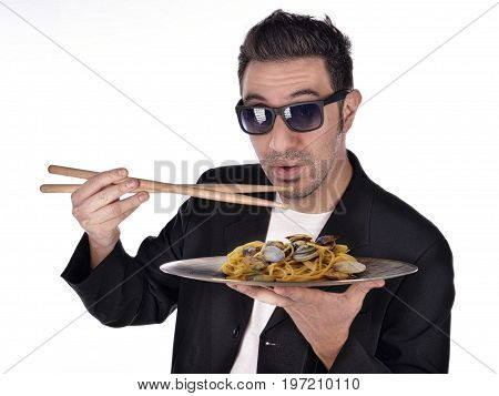 funny face of jazz drummer when eating spaghetti