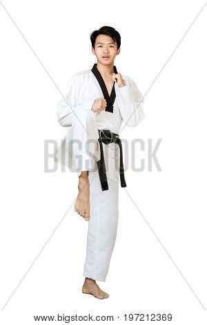 Portrait Of An Asian Professional Taekwondo Black Belt Degree (dan) Preparing For Kick. Isolated Ful