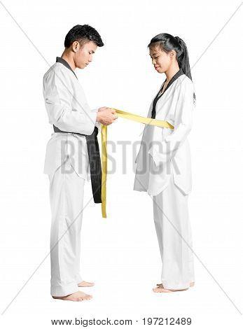 Portrait Of An Asian Man Professional Taekwondo Black Belt Degree (dan) Gives Yellow Belt Degree To