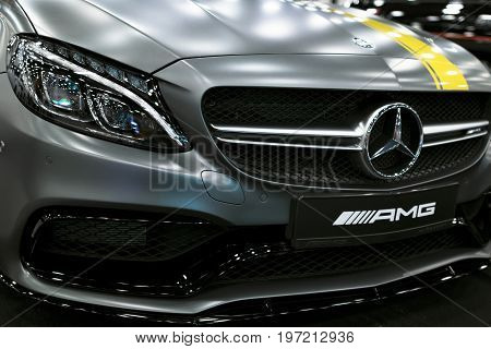 Sankt-Petersburg Russia July 21 2017: Front view of a Mercedes Benz C 63s coupe 2017. Front Headlight. dark Matt color .Car exterior details. Photo Taken at Royal Auto Show July 21