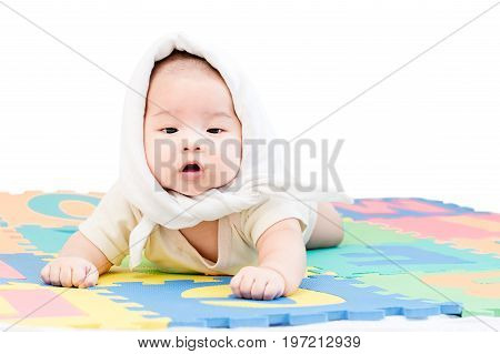 Portrait Of A Little Adorable Newborn Infant Baby Girl With Handkerchief On The Head And Lying On Th