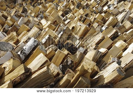 Woodpile from dry birch firewood prepared for the winter