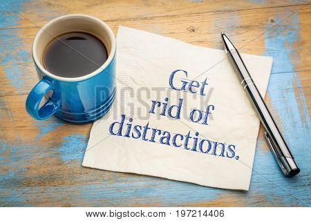 Get rid of distractions advice or reminder - handwriting on a napkin with a cup of espresso coffee