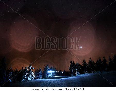 Film Effect. Hut In Winter Mountains.. Cross Country Trails In Mountains.  Evening In Winter Mountai